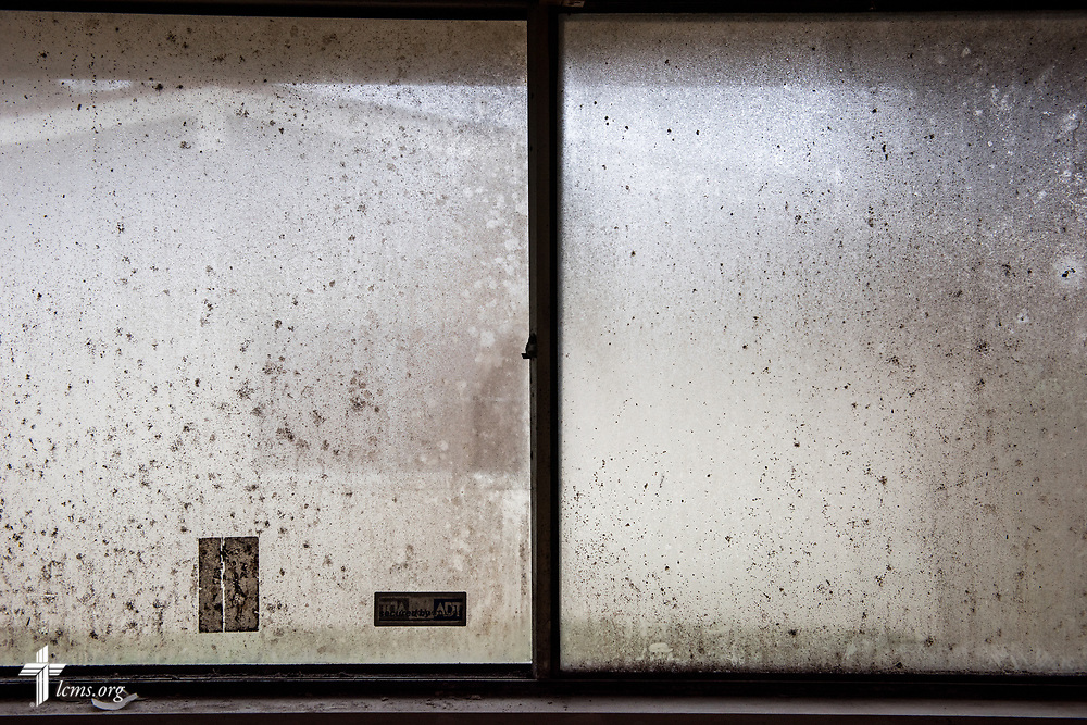 A window still bears the mold and dirt from Hurricane Harvey at a home on Wednesday, Feb. 7, 2018, in Port Arthur, Texas.  LCMS Communications/Erik M. Lunsford