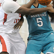 Brunswick Community College's Kevin Rowett drives against Catonsville's Keon Scott Sunday November 9, 2014 at Cape Fear Community College in Wilmington, N.C. (Jason A. Frizzelle)