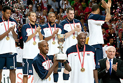 (L/R) Chauncey Billups #4 and Lamar Odom #14 of the USA Senior Men's National Team with ex-president of FIBA Bob Elphinston hold up the trophy following the game against Turkey during the 2010 World Championships of Basketball on September 12, 2010 at the Sinan Erdem Dome in Istanbul, Turkey. USA defeated Turkey 81 - 64 and became World Champion 2010. (Photo By Vid Ponikvar / Sportida.com)