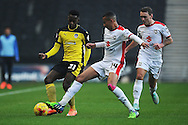 Gavin Massey of Colchester United does battle with Dele Alli of MK Dons during the Sky Bet League 1 match between Milton Keynes Dons and Colchester United at stadium:mk, Milton Keynes<br /> Picture by Richard Blaxall/Focus Images Ltd +44 7853 364624<br /> 29/11/2014