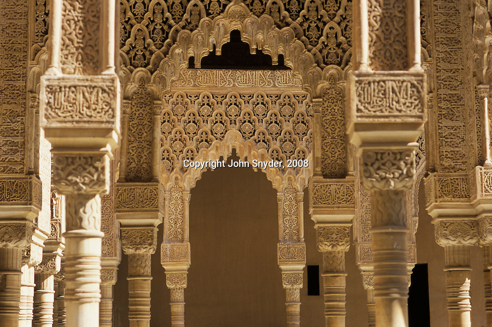 "Midday light reveals myriad facets of the walls of the Alhambra, meaning ""red castle"" in Arabic, in Granada--fortress and last home of the Moors before being expelled from Spain."