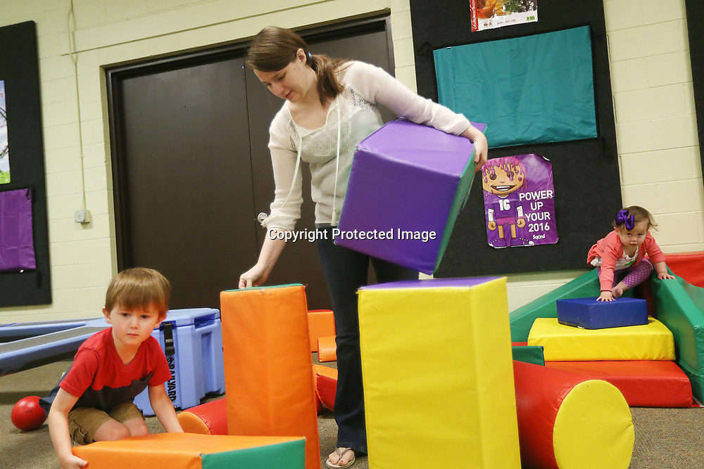 """Tifphanie Franks stacks up blocks with her kids Liam, 3, left, and Petra, 1, Monday morning during the """"We Love Our Moms!"""" Hip Hoppers session at Healthworks!. Hip Hoppers are preschool age kids that meet twice a month year round."""