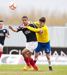 Falkirk's Lyle Taylor holds off a challenge from Morton's Thomas O'Ware..Falkirk 4 v 1 Morton, 4/5/2013..© Michael Schofield..