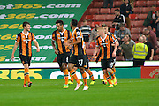 Hull City midfielder James Weir (17) celebrates with his team after he scores to make it 1-2 to his team during the EFL Cup match between Stoke City and Hull City at the Britannia Stadium, Stoke-on-Trent, England on 21 September 2016. Photo by John Marfleet.