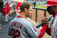 Josh Hamilton #32 of the Los Angeles Angels gets ready in the dugout with first base coach Alfredo Griffin #4 before a game against the Minnesota Twins on April 16, 2013 at Target Field in Minneapolis, Minnesota.  The Twins defeated the Angels 8 to 6.  Photo: Ben Krause