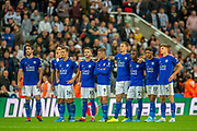 The Leicester City players watch from the half way line during the penalty shoot-out of the EFL Cup match between Newcastle United and Leicester City at St. James's Park, Newcastle, England on 28 August 2019.