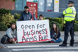 London, UK. 7 September, 2019. Activists holding a banner take part in a sixth day of Stop The Arms Fair protests outside ExCel London against DSEI, the world's largest arms fair. The sixth day of protests was billed as a Festival of Resistance and included performances, entertainment for children and workshops as well as activities intended to disrupt deliveries to ExCel London for the arms fair.