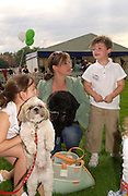 Emma Forbes with Scoobie and Alfie, Macmillan dog day, in aid of Macmillan Cancer Relief, Chelsea , 6 July 2004. SUPPLIED FOR ONE-TIME USE ONLY-DO NOT ARCHIVE. © Copyright Photograph by Dafydd Jones 66 Stockwell Park Rd. London SW9 0DA Tel 020 7733 0108 www.dafjones.com