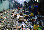 Panamanians walk through the rubble of a market destroyed by US bombs during the US invasion of Panama, December 1989.