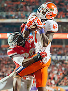 January 3, 2014 - Miami Gardens, Florida, U.S: Ohio State Buckeyes linebacker Trey Johnson (36) is not able to defend a touch down catch by Clemson Tigers wide receiver Martavis Bryant (1) during the Discover Orange Bowl between the Clemson Tigers and the Ohio State Buckeyes at Sun Life Stadium in Miami Gardens, Fl