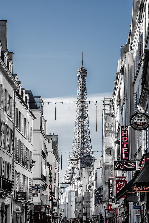 Where: Paris, France.<br /> Of course we have to photograph the eiffel tower when in Paris. I really love the way the Eiffel tower seems to be towering over the typical Parisian street.