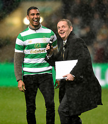 Celtic new signing Marvin Compper gets soaked as he is paraded in front of the fans during the half time break during the Scottish Premiership match at Celtic Park, Glasgow. PRESS ASSOCIATION Photo. Picture date: Wednesday December 20, 2017. See PA story SOCCER Celtic. Photo credit should read: Ian Rutherford/PA Wire. RESTRICTIONS: EDITORIAL USE ONLY
