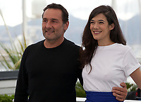 Director Gilles Lellouche and actress Mélanie Doutey at the Le Grand Bain (Sink Or Swim) film photo call at the 71st Cannes Film Festival, Sunday 13th May 2018, Cannes, France. Photo credit: Doreen Kennedy