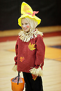 Middletown, New York  - A child in a scarecrow costume waits to play a game in the gymnasium during the Middletown YMCA Family Fall Festival on Oct. 29, 2011.