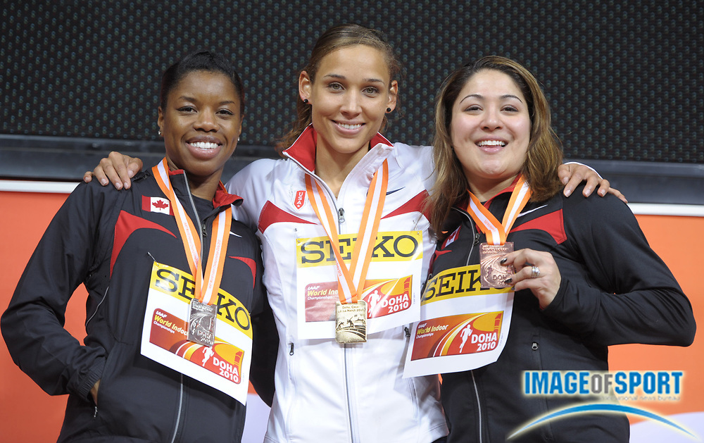 Mar 13, 2010; Doha, QATAR; Lolo Jones (USA), center, poses with silver medalist Perdita Felicien  (left) and bronze medalist Priscilla Lopes-Schliep (right), both of Canada, after winning the women's 60m hurdles in a championship record 7.72 in the IAAF World Championships in Athletics at the Aspire Dome.