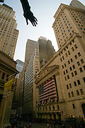 A view of New York Stock Exchange in Wall Street with George Washington's statue hand.