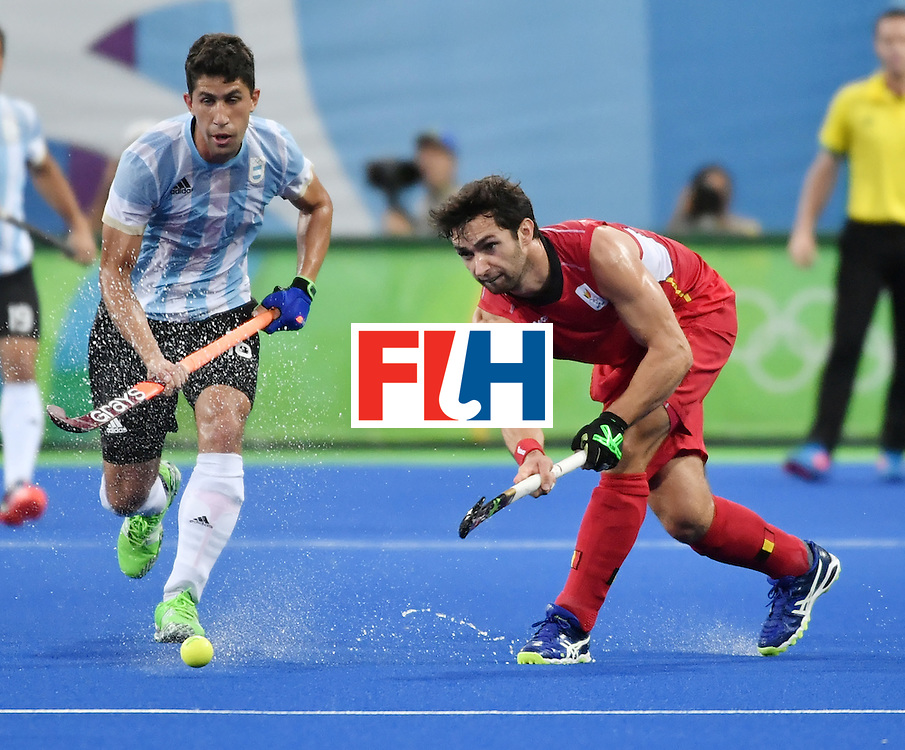 Argentina's Ignacio Ortiz (L) vies with Belgium's Loick Luypaert during the men's Gold medal field hockey Belgium vs Argentina match of the Rio 2016 Olympics Games at the Olympic Hockey Centre in Rio de Janeiro on August 18, 2016. / AFP / Pascal GUYOT        (Photo credit should read PASCAL GUYOT/AFP/Getty Images)