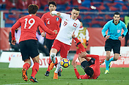 Chorzow, Poland - 2018 March 27: Piotr Zielinski from Poland fights for the ball while Poland v South Korea International Friendly Soccer match at Stadion Slaski on March 27, 2018 in Chorzow, Poland.<br /> <br /> Mandatory credit:<br /> Photo by © Adam Nurkiewicz / Mediasport<br /> <br /> Adam Nurkiewicz declares that he has no rights to the image of people at the photographs of his authorship.<br /> <br /> Picture also available in RAW (NEF) or TIFF format on special request.<br /> <br /> Any editorial, commercial or promotional use requires written permission from the author of image.