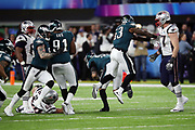 Philadelphia Eagles outside linebacker Nigel Bradham (53) leaps and celebrates after a strip sack fumble caused by Philadelphia Eagles defensive end Brandon Graham (55) and recovered by Philadelphia Eagles rookie defensive end Derek Barnett (96) that sets up an Eagles field goal late in the fourth quarter during the 2018 NFL Super Bowl LII football game against the New England Patriots on Sunday, Feb. 4, 2018 in Minneapolis. The Eagles won the game 41-33. (©Paul Anthony Spinelli)