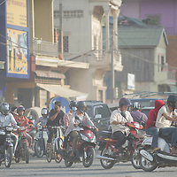 Jan 3, 2013 - Motorcycle drivers use masks to protect against smog, which do little to filter out harmful particles and gases in air pollution, as they navigate traffic through the Cambodian capital city of Phnom Penh.<br /> <br /> Story Summary: It is said that the battle over global warming is to be won or lost in Asia. With growing populations and new economic boom in the global markets across Asia countries like India, Nepal and Cambodia have to grapple with the success and the environmental disaster that comes with ramped up production in unchecked or unregulated industries to compete in todays marketplace. The catastrophic air pollution makes for new problems to be dealt with such as a future health crisis, quality of life issues and the tarnished image of reduced visibility to world heritage sites for tourism.