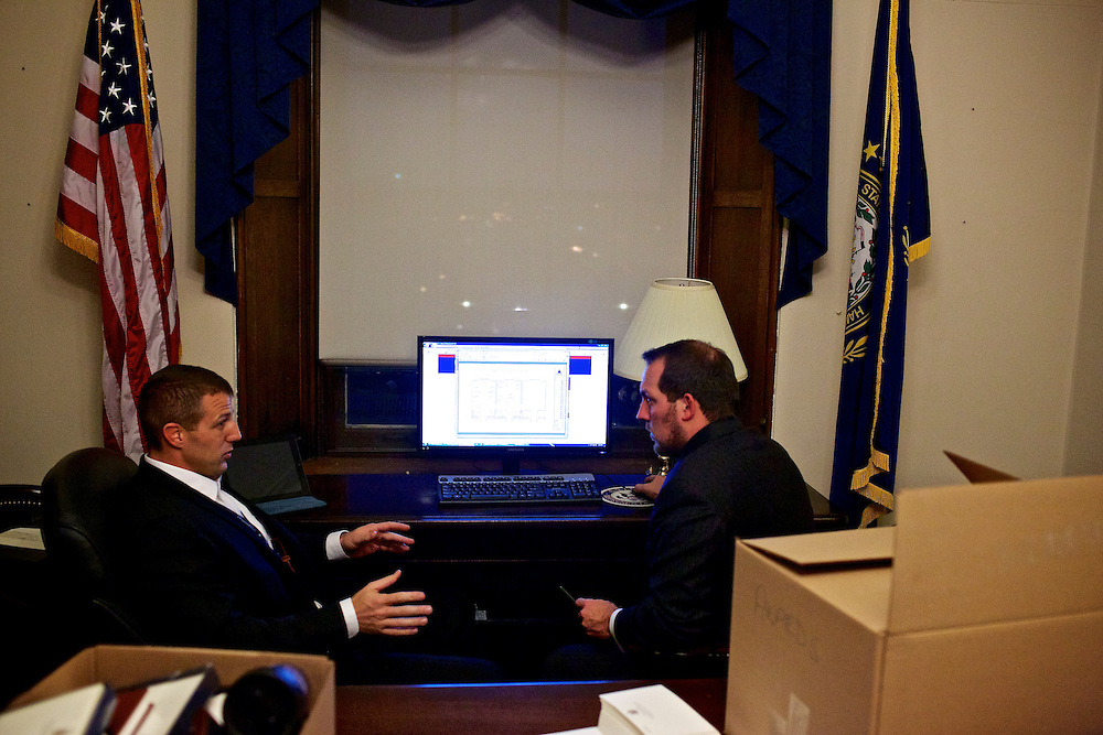 Congressman-elect Markwayne Mullin, from Oklahoma's 2nd District, left, makes decisions about his future office with his advisor Trebor Worthen, right, in the Longworth House Office Building in Washington, DC on Nov. 29, 2012.
