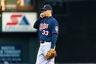 Justin Morneau #33 of the Minnesota Twins warms his hand during Game 2 of a split doubleheader against the Miami Marlins on April 23, 2013 at Target Field in Minneapolis, Minnesota.  The Marlins defeated the Twins 8 to 5.  Photo: Ben Krause