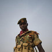 April 24, 2012 - Panakuach, South Sudan: A SPLA soldier stands by the scene where a bomb dropped by the SAF air force landed minutes earlier near the last defensive line outside the village of Panakuach, 70 kilometers north of Bentiu...South Sudan and their northern neighbors, Sudan, have in the past two weeks been involved in heavily clashes over border disputes. Bentiu and neighboring villages have been under constant bombardment by the troops os Karthoum , who established their positions around 10 kilometers into South Sudan's territory. The international community is concerned about the possibility of a full on war between the two countries. (Paulo Nunes dos Santos/Polaris)