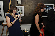 AMY MACLAREN TWEETING, The 2011 Groucho Club Maverick Award. The Groucho Club. Soho, London. 14 November 2011. <br /> <br />  , -DO NOT ARCHIVE-© Copyright Photograph by Dafydd Jones. 248 Clapham Rd. London SW9 0PZ. Tel 0207 820 0771. www.dafjones.com.