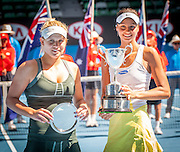 Elizaveta Kulichkova (right)  of Russia with her championship trophy after she dominated Jana Fett (left) of Croatia in the Australian Open Junior Girl's Open Singles Final in Melbourne's Rod Laver Arena. Kulichkova won the match 6-2, 6-1.