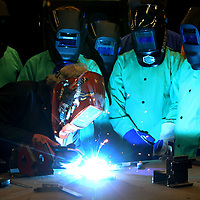 Ron Brady, welding instructor at ICC in Belden, demonstrates how to lay a FIllet Weld to middle school students as they attend the welding part of the ICC Advanced Manufacturing Camp on Wednesday afternoon. The camp is a technical, hands-on experience to introduce students to 21st century manufacturing technology and basic entrepreneurial skill.