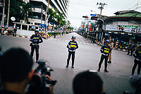 Police line the roads before the funeral procession of King Bhumibol on June 14, 2016 in Bangkok, Thailand. Thailand's King Bhumibol Adulyadej, the world's longest-reigning monarch, died at the age of 88 in Bangkok's Siriraj Hospital on Thursday after his 70-year reign. Prime Minister Prayut Chan-ocha made a statement Thailand would hold a one-year mourning period as the Crown Prince Maha Vajiralongkorn confirmed that he would perform his duty as heir to the throne.