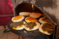 Israel, Middle East, Kfar Hassidim, flatbreads baking in oven.  PR