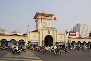 28 MARCH 2012 - HO CHI MINH CITY, VIETNAM:   Main entrance to the Ben Thanh Market in Ho Chi Minh City, Vietnam. Ben Thanh Market is a large market in the downtown area of Ho Chi Minh City (Saigon), Vietnam in District 1. The market is one of the earliest surviving structures in Saigon and one of the city's landmarks, popular with tourists seeking local handicrafts, textiles,ao dais (Vietnamese traditional dresses), and souvenirs, as well as local cuisine. The market developed from informal markets created by early 17th century street vendors gathering together near the Saigon River. The market was formally established by the French colonial powers in 1859. This market was destroyed by fire in 1870 and rebuilt to become Saigon's largest market. In 1912 the market was moved to a new building and called the New Ben Thanh Market to distinguish over its predecessor. The building was renovated in 1985.   PHOTO BY JACK KURTZ