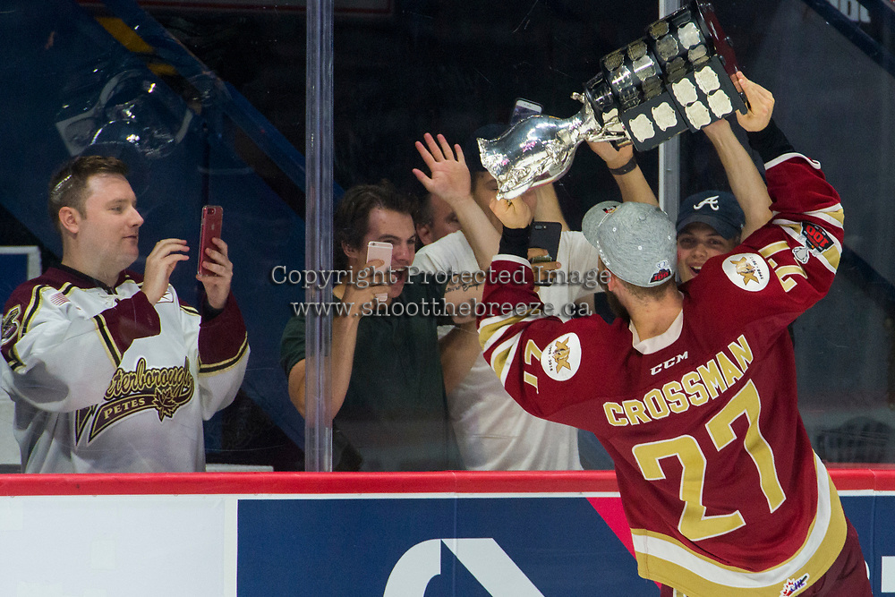 REGINA, SK - MAY 27:  Ethan Crossman #27 of Acadie-Bathurst Titan skates to the glass with the memorial cup trophy to celebrate with friends after the win against the Regina Pats at Brandt Centre - Evraz Place on May 27, 2018 in Regina, Canada. (Photo by Marissa Baecker/CHL Images)