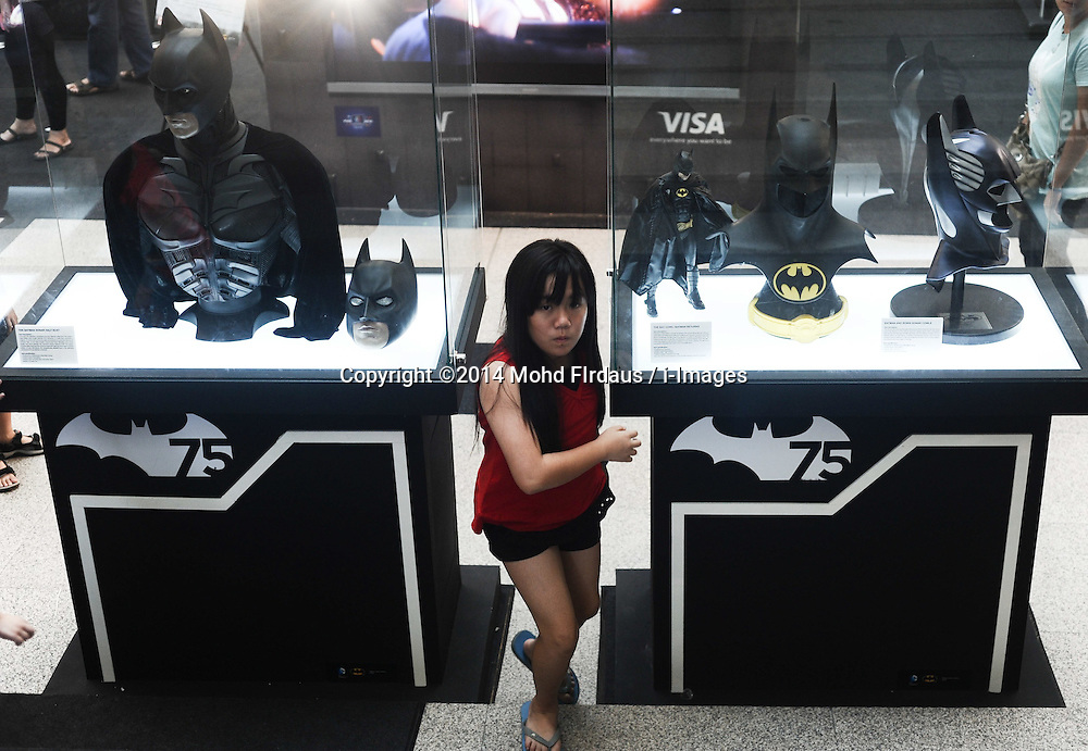 A girl walks through a Batman figure on display during a exhibition in conjunction with Batman's 75th anniversary in a shopping mall in Kuala Lumpur on Jun 02, 2014. The Batman 75th Anniversary celebration Malaysia is from 28 May 2014 & will run till 15 June 2014, Monday, 2nd June 2014. Picture by Mohd FIrdaus / i-Images