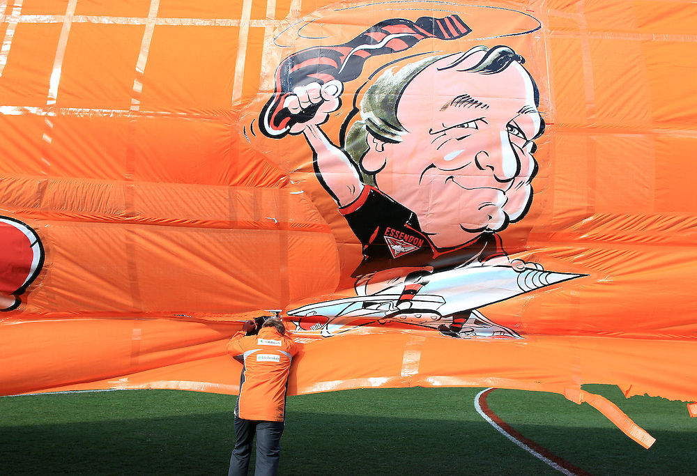 Kevin Sheedycoach of the Giants makes his way onto the ground celebrating his 1000th game during the AFL Round 19 match between the GWS Giants and Port Adelaide Power at Skoda Stadium, Sydney. (Photo: Craig Golding/AFL Media)