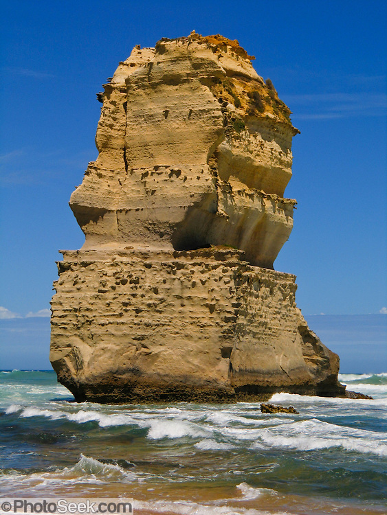 "One of the two sea stacks of ""Gog and MaGog"" rises from the Indian Ocean (or Southern Ocean according to Australian geographers) offshore of Port Campbell National Park, Victoria, Australia. Twelve Apostles Marine National Park protects a collection of miocene limestone rock stacks offshore of the Great Ocean Road. The Great Ocean Road (B100) is a 243-km road along the southeast coast of Australia between Torquay and Warrnambool, in the state of Victoria. Dedicated to casualties of World War I, the Great Ocean Road was built by returned soldiers between 1919 and 1932 and is the world's largest war memorial."