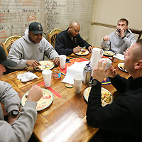 A handful of Tupelo firefighters sit around the table in the kitchen of Fire Station Number 1 as all seven Tupelo fire stations from B shift gather for Christmas breakfast at fire station number 1 in downtown Tupelo on Christmas morning.