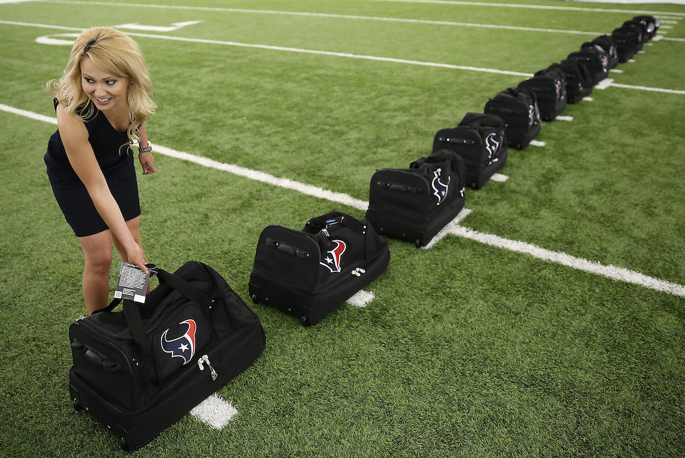 4/16/2014: Former Houston Texans cheerleader Amanda Golden from 2007-11 puts out Cheerleading bags before the announcement. Fifty girls showed up on April 16, 2014 at the Houston Texans practice facility in Houston, Texas to see which 35 girls made the 2014-2015, Houston Texans Cheerleading Team.
