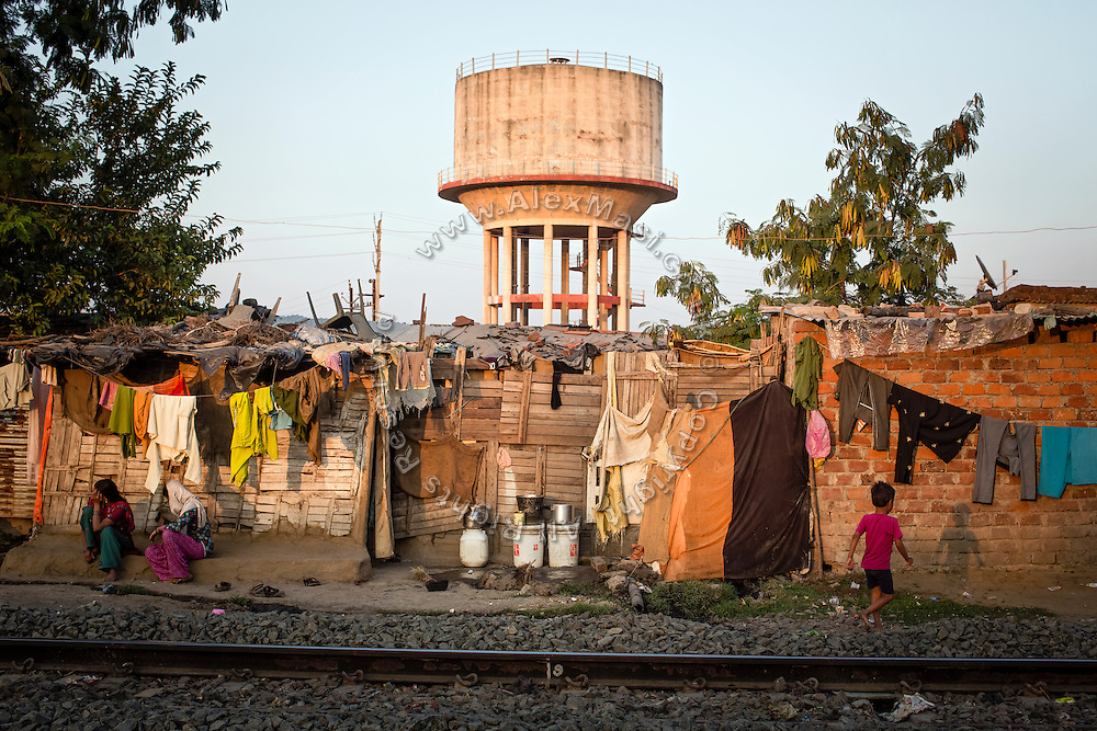 A large cement water tank is standing behind makeshift homes in New Arif Nagar, one of the contaminated colonies next to the abandoned Union Carbide (now DOW Chemical) industrial complex, in Bhopal, Madhya Pradesh, central India.