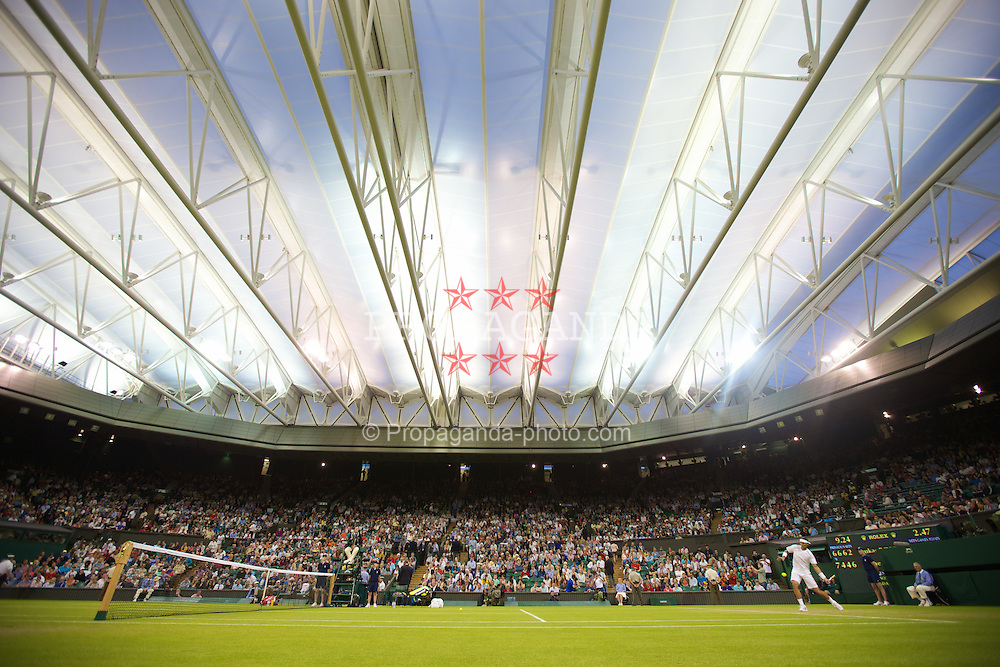 LONDON, ENGLAND - Thursday, June 28, 2012: Rafael Nadal (ESP) under the closed centre court roof during the Gentlemen's Singles 2nd Round  match on day four of the Wimbledon Lawn Tennis Championships at the All England Lawn Tennis and Croquet Club. (Pic by David Rawcliffe/Propaganda)