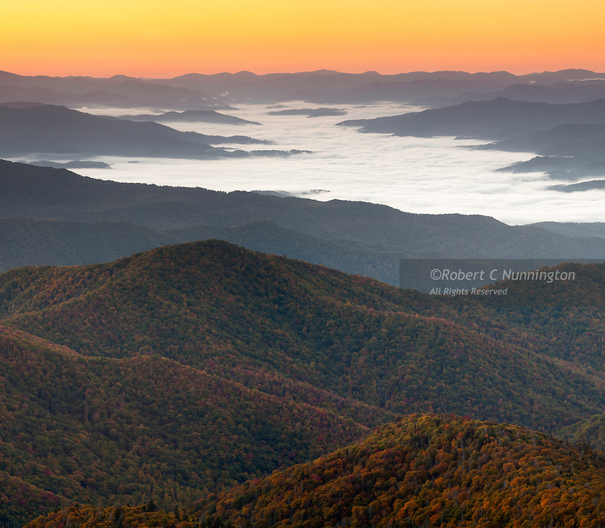 """With its biodiversity and dramatic scenery, the Great Smoky Mountains National Park is one of the Earth's natural treasures. The """"smoke"""" which gives the mountain range its name is due to the incredibly moist atmosphere resulting from the high rainfall, large tree density and temperature variations, although latterly much of the smoke is due to pollution. Taken at sunrise near Clingman's Dome, the highest peak in the park."""