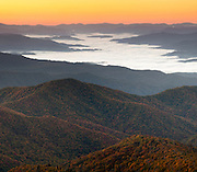 "With its biodiversity and dramatic scenery, the Great Smoky Mountains National Park is one of the Earth's natural treasures. The ""smoke"" which gives the mountain range its name is due to the incredibly moist atmosphere resulting from the high rainfall, large tree density and temperature variations, although latterly much of the smoke is due to pollution. Taken at sunrise near Clingman's Dome, the highest peak in the park."