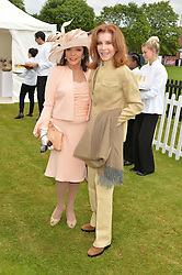 Left to right, DAME JOAN COLLINS and STEFANIE POWERS at the Cartier Queen's Cup Polo final at Guard's Polo Club, Smiths Lawn, Windsor Great Park, Egham, Surrey on 14th June 2015