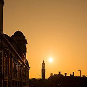 Bradford Alhambra and Town Hall silhouetted by early morning sunlight.