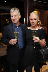 NICHOLAS KNEALE the founder of Fired Earth and his daughter OLIVIA KNEALE at a signing of Redeeming Features - Nicky Haslam's autobiography hosted by House & Garden magazine held at Ralph Lauren, Bond Street, London on 29th October 2009.