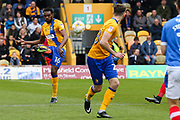 Mansfield defender Hayden White clears the ball during the EFL Sky Bet League 2 match between Mansfield Town and Portsmouth at the One Call Stadium, Mansfield, England on 29 April 2017. Photo by Aaron  Lupton.
