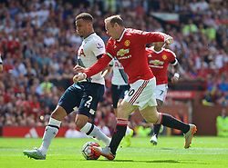 MANCHESTER, ENGLAND - Saturday, August 8, 2015: Manchester United's captain Wayne Rooney has the ball taken off him as Tottenham Hotspur's Kyle Walker scores an own goal during the Premier League match at Old Trafford. (Pic by David Rawcliffe/Propaganda)