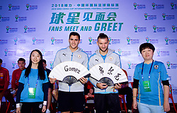 NANNING, CHINA - Saturday, March 24, 2018: Uruguay's Lucas Torreira and Maxi Gómez are presented with traditional Chinese fans during a meet & greet event at the Nanning Wanda Mall during the 2018 Gree China Cup International Football Championship. (Pic by David Rawcliffe/Propaganda)