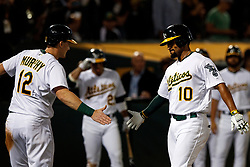 OAKLAND, CA - SEPTEMBER 16: Marcus Semien #10 of the Oakland Athletics is congratulated by Sean Murphy #12 after hitting a two run home run against the Kansas City Royals during the second inning at the RingCentral Coliseum on September 16, 2019 in Oakland, California. The Kansas City Royals defeated the Oakland Athletics 6-5. (Photo by Jason O. Watson/Getty Images) *** Local Caption *** Marcus Semien; Sean Murphy